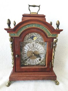 Just listed on eBay this Vintage Warmink 8 Day 9.8 Inch Nut Wood Bracket Clock With Rolling Moon Phase