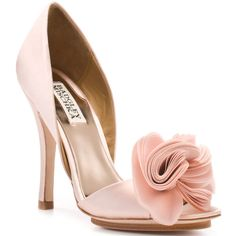 Slip these elegant party heels from luxe fancy shoe designer Badgley Mischka onto your feet and dance the night away. Randall is a sandal in pink satin