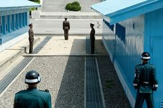 Joint Security Area, Korea - DMZ border between North and South Korea. The guards in green are South Korean, the guards in brown are North Korean