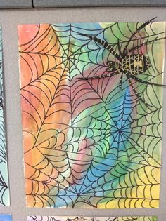 Draw webs with sharpie.  Watercolor wash.  Spider is drawn with paint markers on black paper