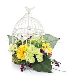Keep those flowers from flying away!     Caged Arrangement