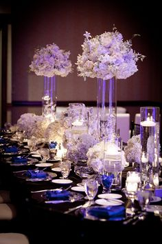 Assorted white floral balls placed high and low + navy blue details (very very interesting!)
