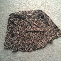 Button up Floral Skater Skirt Never worn. True to size, but waist bad stretches. comes up to mid thigh. Agaci Skirts Circle & Skater