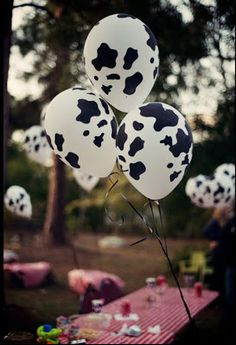 Draw spots on white balloons! There's also a pink m & m piggy cake, a cow one made of marshmallows and cocoa puffs, and a wheelbarrow full of goody bags