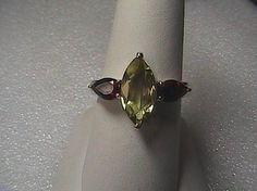 Brand New with tag very lovely piece Sterling Silver Quartz Garnet Ring, 2.86 carats, weigh 3.8 grams, size 7, hallmarked 725. Original Price $210.