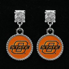 Ladies, let your Cowboys pride shine in any outfit with these crystal stud earrings featuring a team logo charm and a large rhinestone stud for truly dazzling team style! For a complete look, pair them with the matching crystal stud necklace.