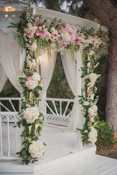 White, Pink, And Blush Flowers Decorate White Washed Wedding Ceremony Gazebo  At The Green