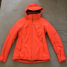 NEW! Arc'teryx Orange goretex pro shell small Brand new and never worn. The best snow coat you can buy! This jacket retails for over $1000! Goretex material, snow skirt, lightly insulated with hood. Waterproof for comfort. Size small. Bundle to save 15% on 3+ items! Arc'Teryx Jackets & Coats