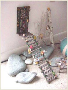I have collected so many sticks for our fairy house...now I see a great way to use them in unexpected places!