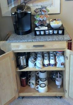 Simple buffet turned coffee bar. Clears out a TON of cabinet and counter space, plus keeps all of your coffee and tea stuff together!