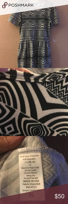 Lularoe Amelia in classic Black & White This gently used dress will be the workhorse in your wardrobe! The black & white pattern gives flexibility in dressing it up or down. Add a blazer & ballet flats for the office, pair it with a denim jacket and chuck taylors on the weekend OR  great shoes with a pop of color & matching bag will take you out on the town! LuLaRoe Dresses Midi