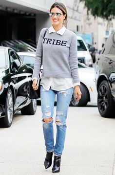Alessandra Ambrosio in a graphic crew neck sweater, collared button-down shirt, and ripped jeans