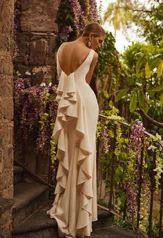 Wear a wedding dress that features waterfall ruffles.