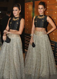 Neha Dhupia in a black sleeveless blouse and a cream skirt @ the Filmfare Awards 2014 .