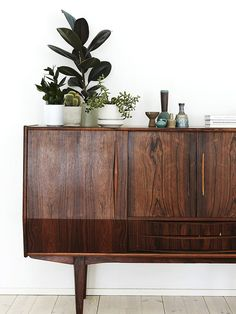 Wooden sideboard with vases and objects