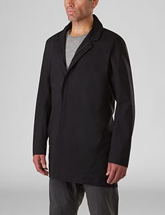 Partition Coat FL Men's Lightweight, breathable and easily packable three-quarter length overcoat with a clean, minimalist design and stowable hood that rolls away into the collar