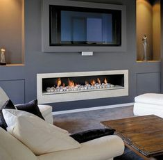 Low profile fireplace with tv above More
