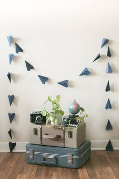 Navy Blue Paper Airplane Garland | Party Decor Paper Airplanes | Folded Planes | Classic Planes | Travel Theme Party | Travel Theme Garland by collectionsbyknb on Etsy https://www.etsy.com/listing/545580194/navy-blue-paper-airplane-garland-party