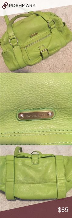 Michael kors purse Perfect for spring. Light green Michael kors purse. Some light stains on the bottom as shown but overall really nice condition Michael Kors Bags