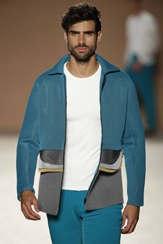 Miquel Suay's jacket with contrasted parts at the waistline. Plain T-shirt and long trousers.