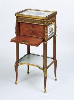 Writing and reading table by Martin Carlin, c. 1784 This little table is a supreme example of the exquisite perfection achieved by these pieces of furniture and would always have been intended as a collector's item. Martin Carlin produced several of this type, which were ostensibly reading or music stands with an adjustable book-rest, tiny drawers and space for writing implements but which were unlikely to have been in daily use. They were bought by aristocratic and royal patrons