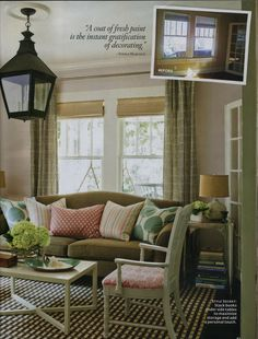 I love the color she painted on these walls - grayish pink called Calamine by Farrow & Ball.  I love the camelback sofa paired with the painted cane back chairs and all the pops of pink, green and brown (note the Ziggurat curtain fabric by Quadrille?).