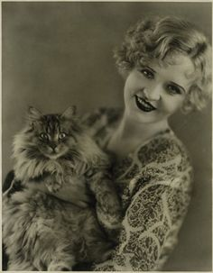Silent-film actress Phyllis Haver with a big-and-furry cat