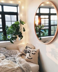 Inspiring interior. Cute modern boho vibes, fun pillow, round mirror. Urban jungle inspired.