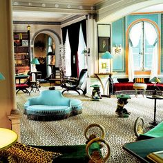 The salon at the interior decorator's country house, featuring her signature shades of blue and green, plus wall-to-wall leopard-spot carpeting.