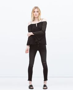 Image 1 of SKINNY TROUSERS WITH KNEE RIPS from Zara