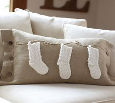 A cozy couch with knit stockings--another pillow idea for Leah  : )