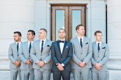 A groom and his groomsmen in grey. Dapper never goes out of style.