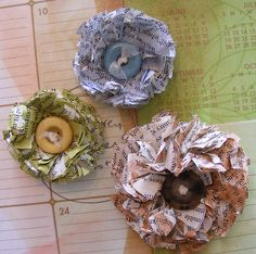 Make these Paper Flowers from old books/ newspaper + a button.  Use on homemade cards or on packages instead of a bow. Glitter spray for Christmas, and a jingle bell in center!!