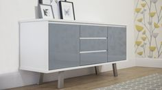 A mid-century modern inspired sideboard that has style and practicality. It's soft close doors and drawers are perfect for the modern home. The glossy finish and angled brushed metal feet give this sideboard it's contemporary look.