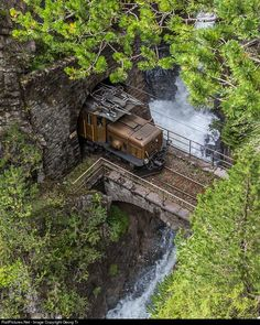 "doyoulikevintage: "" the train cross the bridge of the creek """