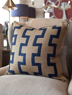 Handmade linen pillow wearing applied linen fretwork banding ( $295.00 )