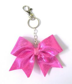 I have a bow key-chain on my backpack that looks just like this 1. Cheer swag. Cheer Backpack, Girly Things, Girly Stuff, Cheer Bows, Cheerleading, Swag, Dots, Drop Earrings, Yahoo Search