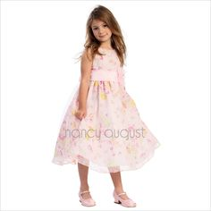 Floral Joy Pink Easter Dress For Girls: This cheery floral joy pink Easter dress features a sensational sleeveless style with a beautiful floral print on a light and airy organza fabric. This simple tea length dress comes with a a adjustable sash tie in the back. Like many of our special occasion dresses, it is versatile and can be used as a flower girl dress, Easter picnic dress, or even as a summer birthday party dress.