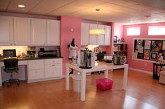 My craftroom - Scrapbook.com. I love all the cupboards and the paint color :) I would rather have black furniture though.