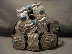 """Located on this piece are 19 fabulous silver conchos, 10 butterfly conchos and 9 fabulous dome shaped conchos. Resting in the center of each 2"""" X 1-1/2"""" oval concho are wonderful Old Kingman turquoise stones as well as around the marvelous 2-3/8"""" X 2"""" silver buckle.   eBay!"""