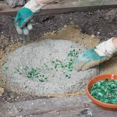 Quikrete in a shallow ground mold - 2-3 inches deep - press in recycled glass or shells - spritz with water - cover with plastic & cure for 7 days