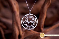 A silver Tree of Love pendant - I've actually based it on the Yin Yang symbol and use it as a symbol of perfection , love and balance.