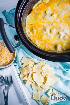 Crockpot Chicken Enchilada Casserole is easy but full of flavor. With green chilies and lots of cheese, this is a crowd pleaser that can feed a crowd.