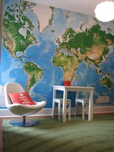 Wall mural map: would change the colors (go more rustic), but love the wall mural map to constantly keep that global worldview in constant focus.