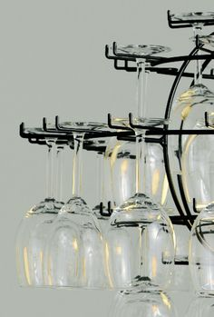 The stemware (not included) is meant to be used and then rehung. By selecting which glasses to hang, you design your own chandelier. Wine Glass Storage, Wine Glass Rack, Wine Cellar Racks, Wine Rack, Wine Glass Chandelier, Carbs In Beer, Wine Tasting Events, Wine Gift Boxes, Lights