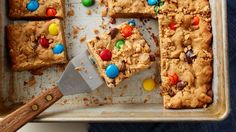 Monster Cookie Bars One of our favorite cookies -- packed with peanuts M&Ms chocolate candies and oats -- gets a super-easy bar makeover! Perfect for parties lunch boxes or anytime you want a sweet bite. Bake Sale Recipes, Cookie Recipes, Dessert Recipes, Bar Recipes, Easy Desserts, Winter Desserts, Yummy Recipes, Recipies, Monster Cookie Bars