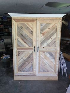 Repurposed Pallet Wardrobe wardrobe/armoire made from reclaimed everything! from the handles that came from a house that is being redone, to the pallets and trim. it is about tall VER…