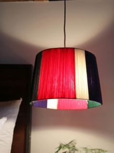 Add Color to a Lampshape with Yarn >> http://www.hgtv.com/shows/danmade/how-tos/how-to-make-a-yarn-lampshade?soc=pinterest