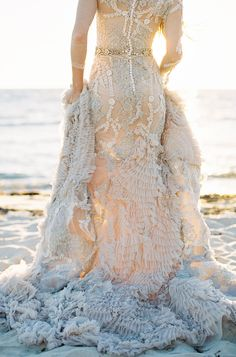 MXM Couture wedding gown with layers of tulle, ruffles, crystals and intricate beading // Mermaid Inspiration With an Other-Worldly Gown  (Instagram: theweddingscoop)