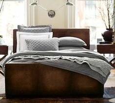 Turner Leather Bed #potterybarn-they call it rustic luxe.  Love the bedside tables, mix of materials, and overhead lighting.
